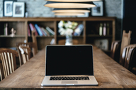 Laptop on a table in a cafe - GUSF00225