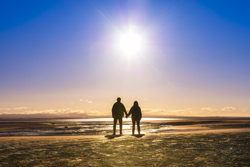 Great Britain, Scotland, Solway Firth, silhouette of mature couple, hand in hand - SMAF00875