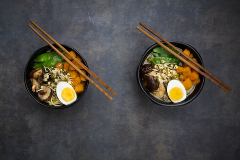 Ramen with noodles, egg, hokkaido pumpkin, mung sprout, shitake mushroom in bowl, chopsticks - LVF06453