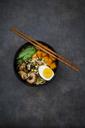 Ramen with noodles, egg, hokkaido pumpkin, mung sprout, shitake mushroom in bowl, chopsticks - LVF06456