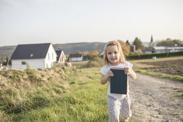 Portrait of blond little girl with a book - KMKF00075