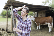 Portrait of smiling woman on a farm - SHKF00797