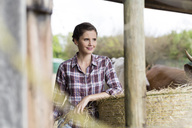 Portrait of smiling woman on a farm - SHKF00800