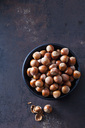 Bowl of hazelnuts on rusty metal - CSF28569