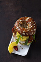 Pretzel pastry garnished with turkey, pineapple, dried tomatoes and rocket - CSF28587