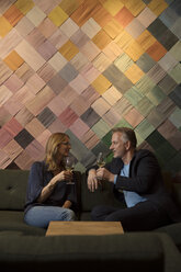 Woman and man meeting in wine bar - SUF00368