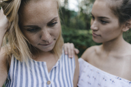 Young woman comforting sad female friend - KNSF03098
