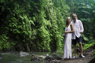 Handsome senior couple in tropical jungle - SBOF00929