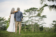 Senior couple looking at tropical landscape - SBOF00971