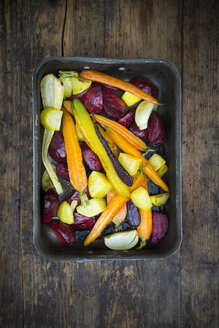 Oven winter vegetables, carrot, beetroot, potato and parsnip in roasting tray - LVF06481