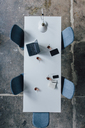 Conference table seen from above, turkish tea, prayer beads, tablet, smartphone, laptop and notebook - JOSF02083