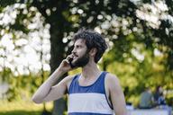 Man on cell phone in park - KNSF03182