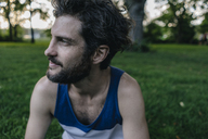 Portrait of man with beard at sunset in a park looking sideways - KNSF03230