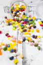 Glass of colourful sweet jellybeans on white wood - LVF06491