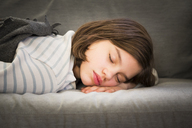 Portrait of girl sleeping on couch - LVF06501