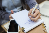 Close-up of businesswoman taking notes - VABF01394