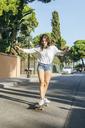 Young woman balancing on skateboard - KIJF01759