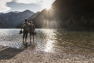 Austria, Tyrol, hiking couple refreshing in mountain lake - UUF12490