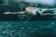 Man swimming in a swimming pool - MFF04232