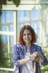 Smiling female gardener in garden - VPIF00282
