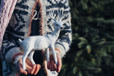 Little girl holding toy reindeer - MJF02220