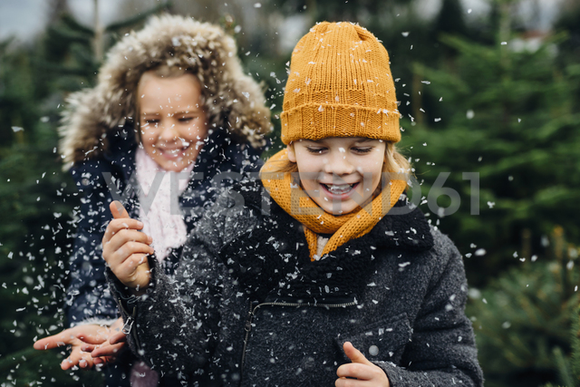 Brother and sister having fun with snow before Christmas - MJF02235
