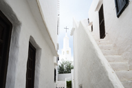Spain, Menorca, Binibequer Vell, white traditional small village, Church - IGGF00273