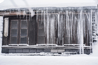 Icicles hanging down from a roof top in winter - IPF00435