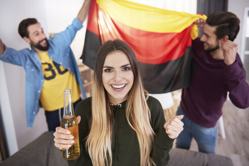 Football fans with German flag celebrating - ABIF00076