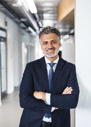 Portrait of smiling mature businessman - HAPF02507