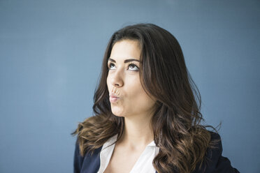 Portrait of businesswoman looking up - MOEF00461
