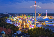 Germany, Bavaria, Munich, View of Oktoberfest fair on Theresienwiese in the evening - SIEF07657