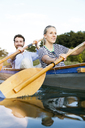 Young couple enjoying a trip in a canoe on a lake - FKF02832