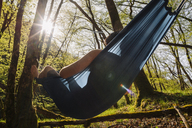 Young man lying in hammock - GUSF00267