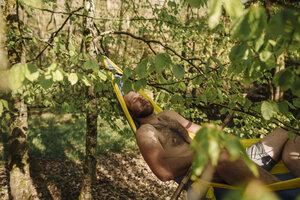 Young man lying in hammock - GUSF00276