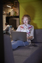 Young woman working in modern creative office, usine laptop - WESTF23856