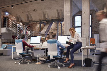 People working in big modern office - WESTF23880