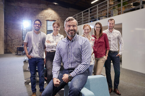 Group portrait of a team of colleagues working for a start up company - WESTF23904