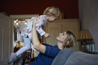 Mother and little daughter having fun together at home - RBF06168