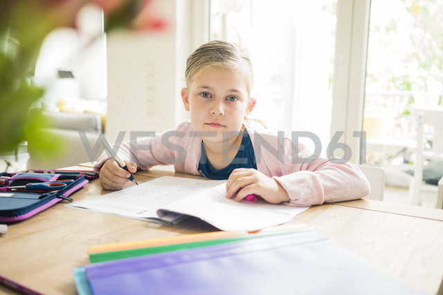 Portrait of girl doing homework at table - MOEF00559