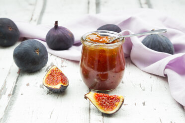 Organic figs and a glass of fig jam on a wood - LVF06527