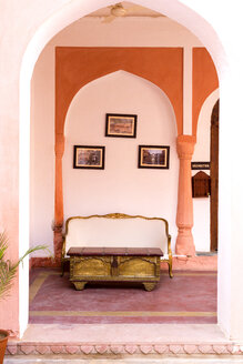 India, Rajasthan, Alwar, Heritage Hotel Ram Bihari Palace, Sofa and old table - NDF00725