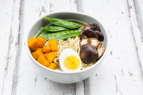 Ramen with noodles, egg, hokkaido pumpkin, mung sprout, shitake mushroom in bowl - LVF06552
