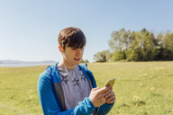 Portrait of young man hiking, listening to music - NMS00186