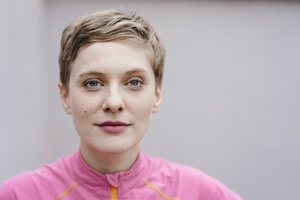 Portrait of confident woman in sportswear - KNSF03322
