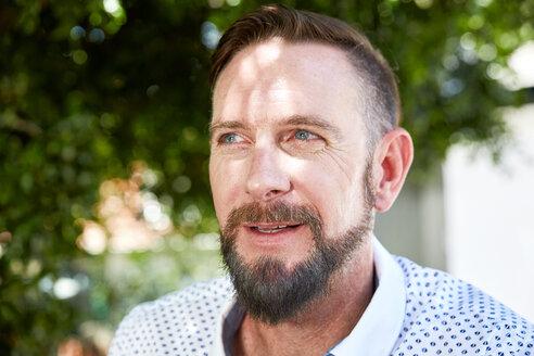 Portrait of bearded man outdoors - SRYF00615