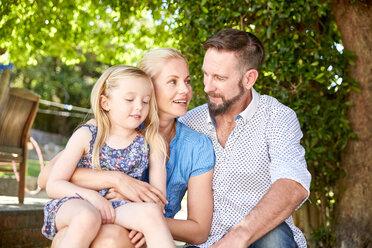 Happy family siting in garden - SRYF00633