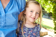 Portrait of smiling girl with mother outdoors - SRYF00639