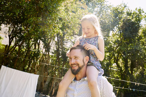 Happy father carrying daughter on shoulders - SRYF00642