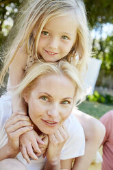 Portrait of happy girl with mother outdoors - SRYF00663